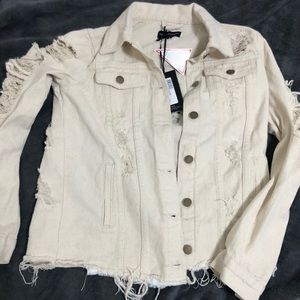 Cream distressed denim jacket